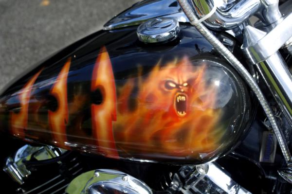 Custom airbrushed flames and tribal demon themed bike