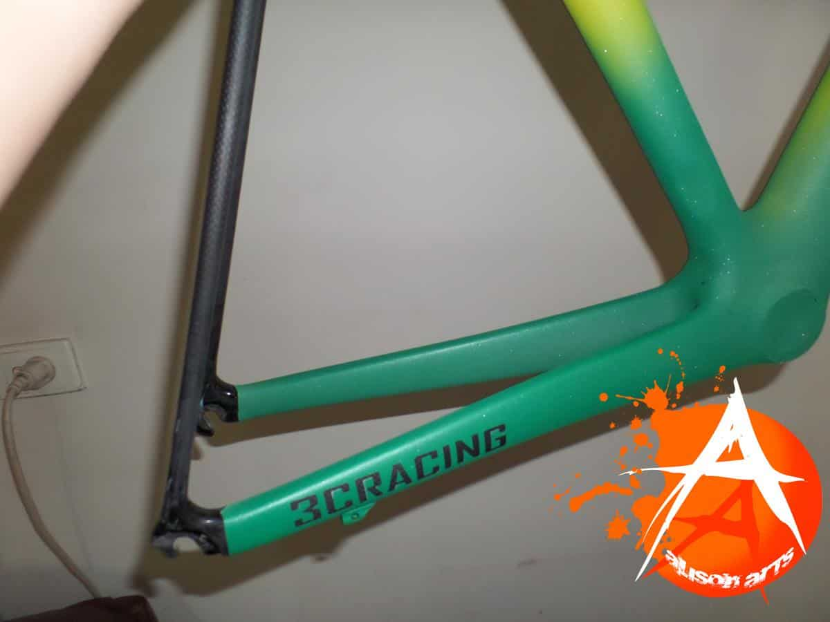 Green and gold airbrushed carbon fibre bike frame
