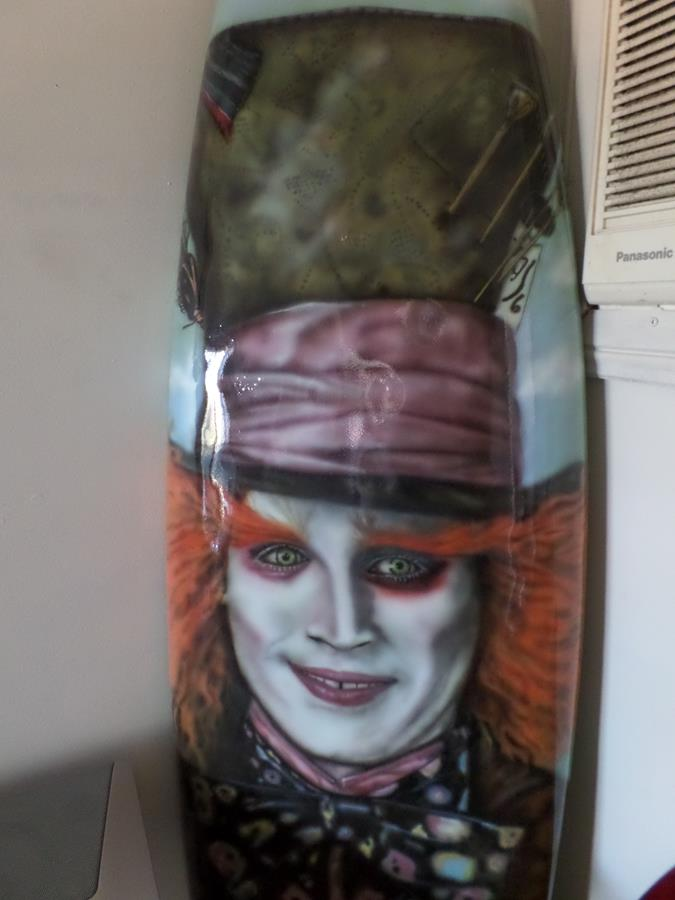 airbrushed mad hatter surfboard