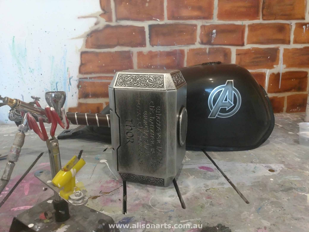 custom airbrushed Marvel props