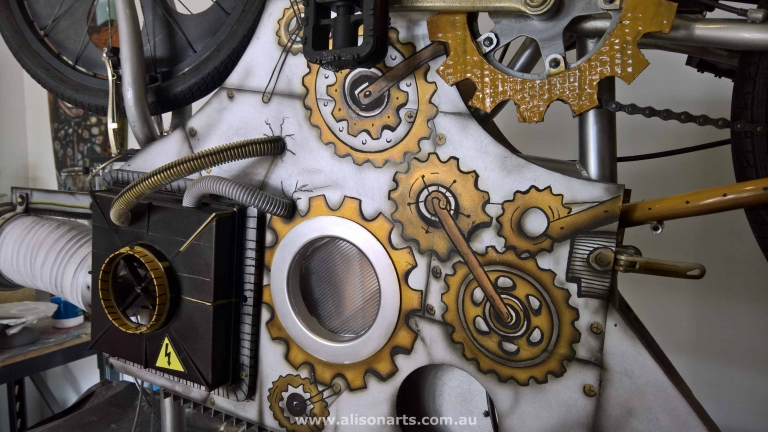 cogs painted on body of prop